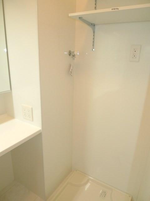 家事動線に配慮された室内洗濯機置き場です