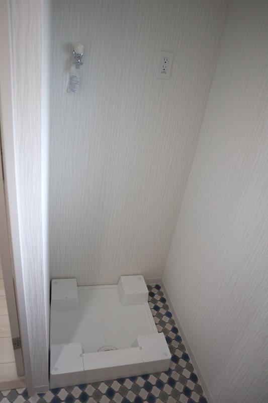 洗濯機置場。お洒落な床デザイン。